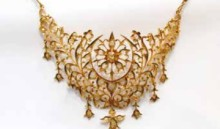 Gold and intan necklace with a crescent moon design