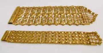 Two gold gelang papan (plank) bracelets
