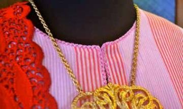Close-up of the baju kurung Telok Blangah trimmed with biji ketumbar