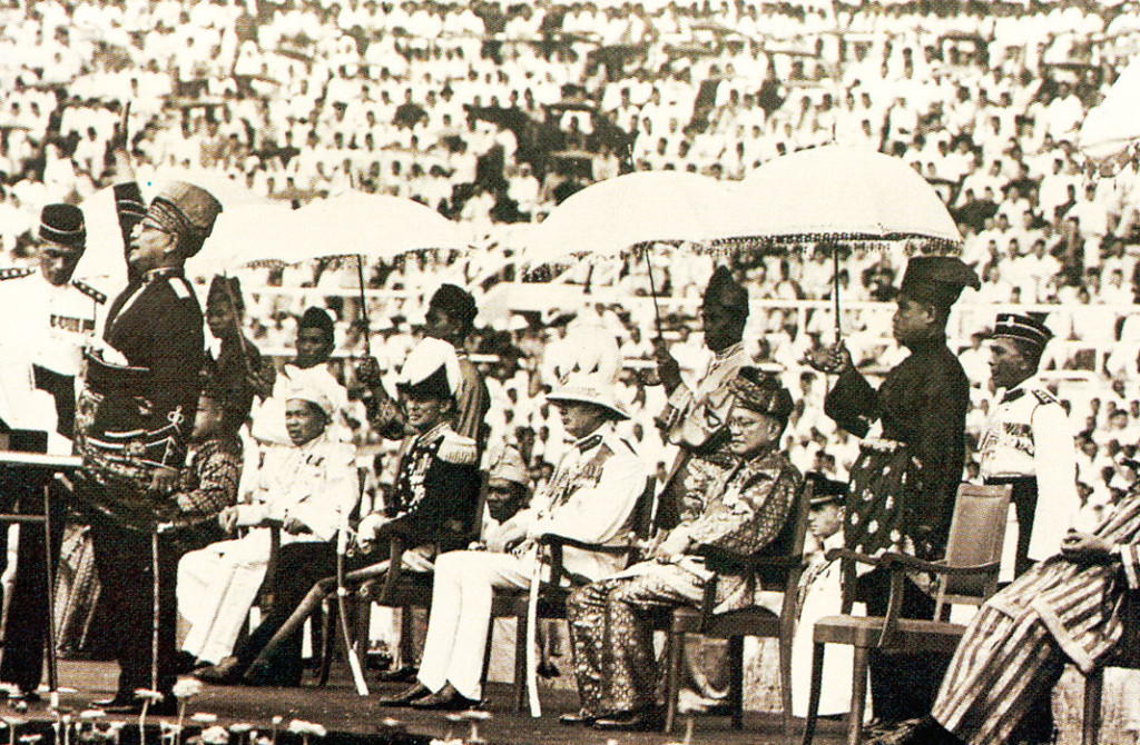 The famous image of the Declaration of Independence by the Federation of Malaya in 1957, with seven shouts of Merdeka! led by Tunku Abdul Rahman (standing, extreme left), the first Prime Minister of Malaya (and Malaysia).