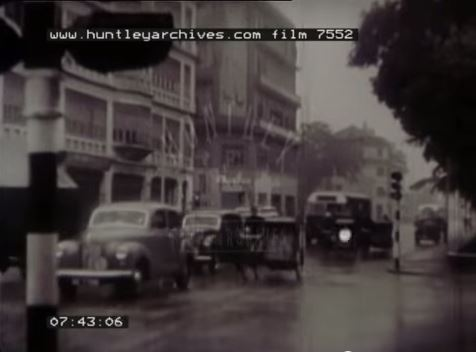 Singapore in the 1930s: traffic in the equatorial torrential rain