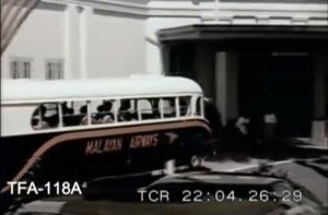 Malayan Airways bus conveying newly-arrived air travelers from Paya Lebar Airport directly to Raffles Hotel.