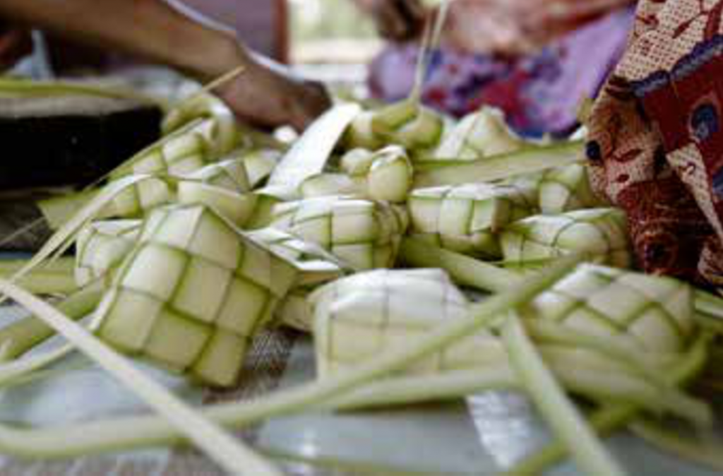 Woven ketupat cases formed out of young coconut leaves